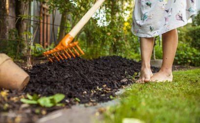 girl-spreading-fertilizer