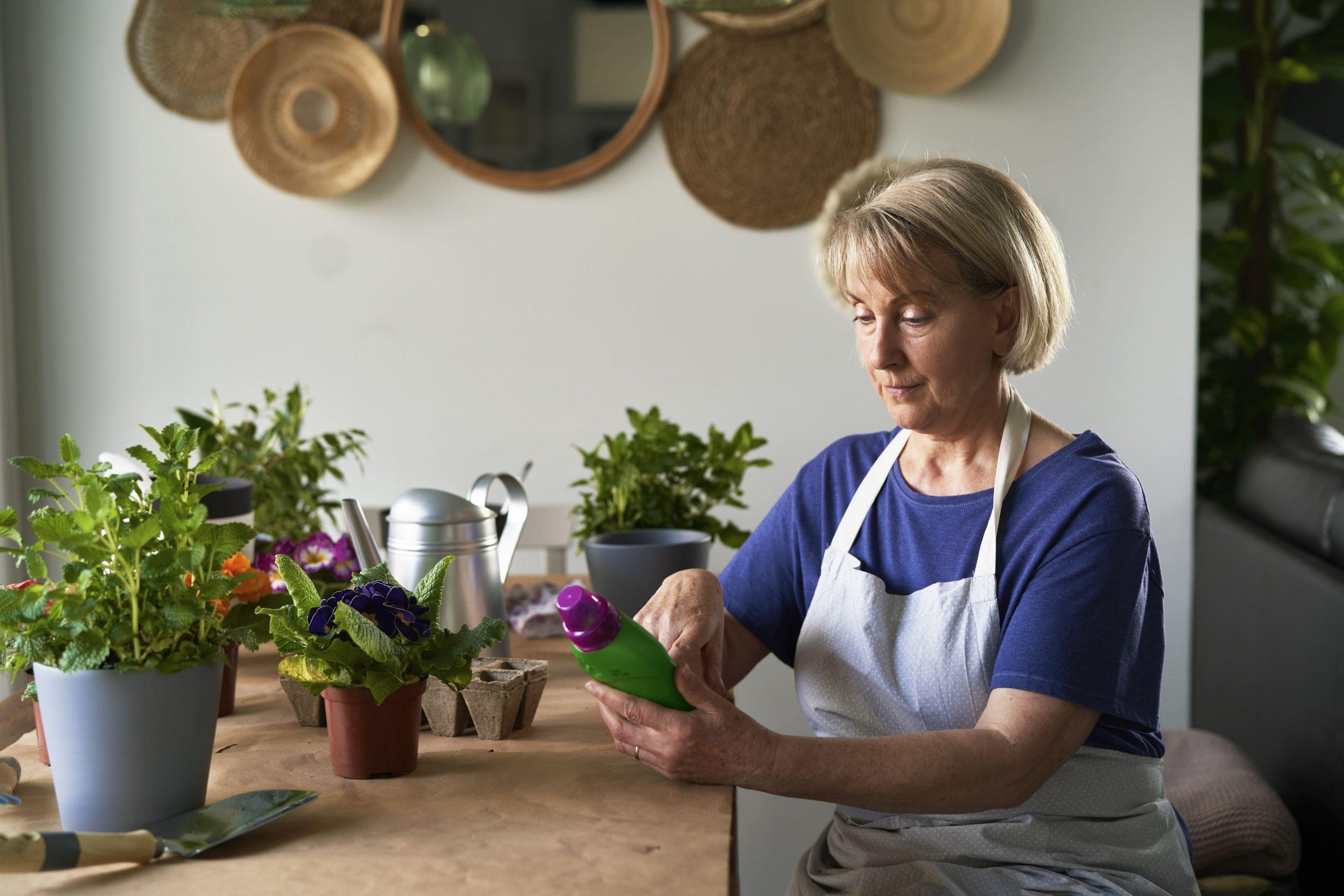 woman-using-fertilizer